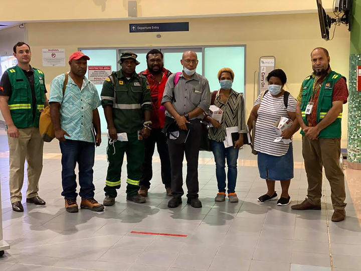 A team with personnel from Papua New Guinea's Department of Health, St John's Ambulance and other agencies, with support from the WHO and UNICEF, flew to East New Britain, 7 April 2020, following confirmation of a covid--19 case in Kokopo.