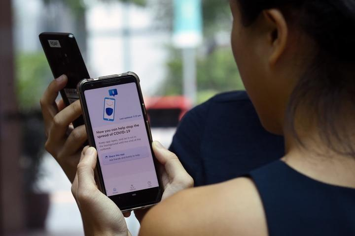Government Technology Agency (GovTech) staff demonstrate Singapore's new contact-tracing smarthphone app called TraceTogether, as a preventive measure against the COVID-19 coronavirus in Singapore .