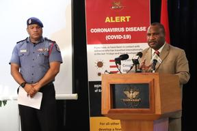 Papua New Guinea's Prime Minister James Marape (right) updates media on the countries covid-19 response, alongside the Emergency Controller, Police Commissioner David Manning.