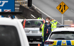 Police check motorists going on motorway in Auckland the day before the Easter long weekend begins.
