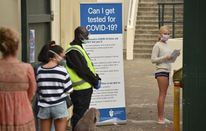People line up at a Covid-19 coronavirus testing station at Bondi Beach in Sydney