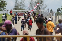 Papua New Guineans cross the Indonesian border for goods and services.
