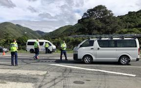 Police officers question drivers at a lockdown checkpoint near Featherston.