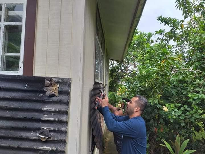 CIVA team putting up shutters before Tropical Cyclone Harold arrives in Tonga