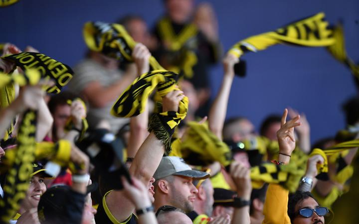 Phoenix fans hold up their scarfs during an A-League match.