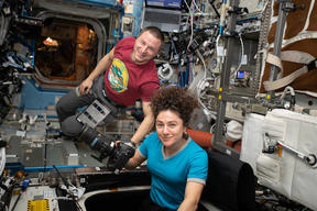 NASA astronauts Andrew Morgan and Jessica Meir photographing earth from the International Space Station, in March.