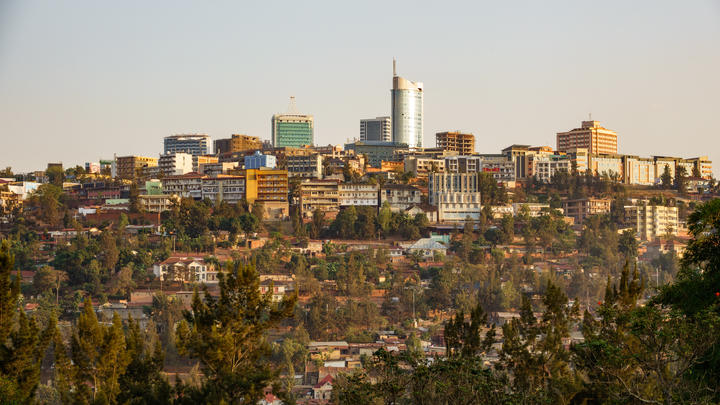 Central Kigali, the capital of Rwanda, mixes huts with modern buildings.