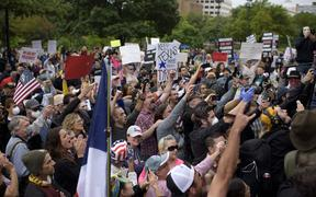 "Protesters yell in unison when Infowars owner Alex Jones arrives to the ""Reopen America"" rally on April 18, 2020 at the State Capitol in Austin, Texas."