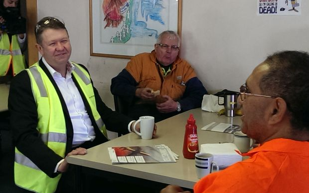 David Cunliffe (left) visiting a cable company in Auckland, on Friday.
