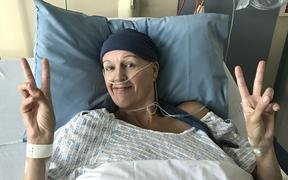 Former Canterbury Flame and Bahrain netball captain Kelly Hutton is in good spirits after surgery for ovarian cancer at Christchurch Women's Hospital last month.