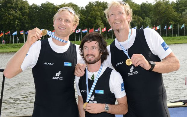 Hamish Bond, cox Caleb Shepherd and Eric Murray with their gold medals