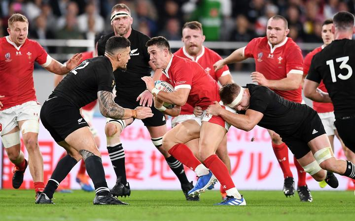 New Zealand v Wales - Rugby World Cup Bronze Final - Owen Watkin of Wales is tackled by Sonny Bill Williams and Sam Cane.
