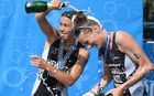 Andrea Hewitt (L) and Nicky Samuels celebrate their podium finish at the World Championship Grand Final.