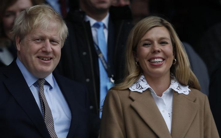 (FILES) In this file photo taken on March 07, 2020 Britain's Prime Minister Boris Johnson (L) with his partner Carrie Symonds attend the Six Nations international rugby union match between England and Wales at the Twickenham, west London.
