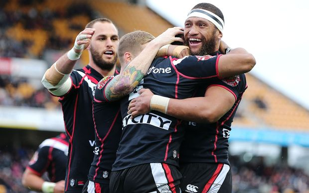 The Warriors celebrate Dominique Peyroux's try.