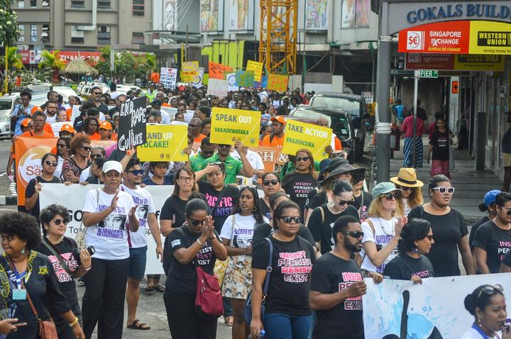 Locals rally against gender-based violence.