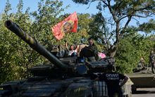 Pro-Russian fighters sit on a tank in southeast of Donetsk, August 31.