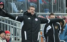 Toronto FC head coach Ryan Nelsen reacts after a play on the field.