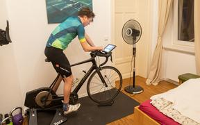 Amateur cyclist Nico Herzog trains on the roller trainer or exercise bike in his bedroom. He uses a bike simulation app called Zwift in winter and during the current initial restrictions for support and motivation.