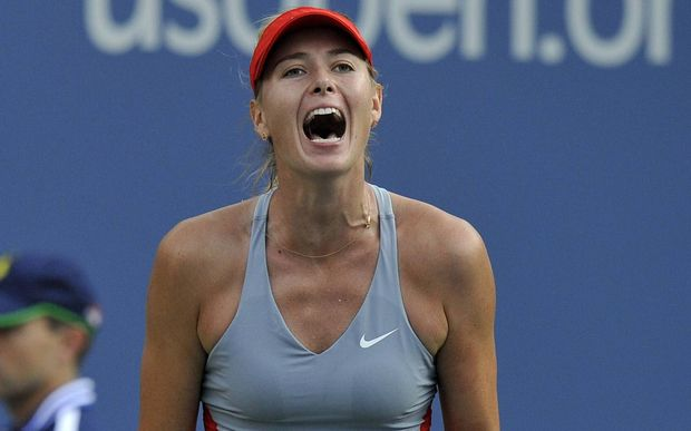 Maria Sharapova of Russia reacts during  match at the U.S. Open, 2014.