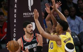 Portland Trail Blazers' Enes Kanter  looks to pass during an NBA basketball game between Los Angeles Lakers.