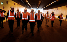 Prime Minister John Key (centre) in the newly named Arras Tunnel under the National War Memorial Park site in Wellington.