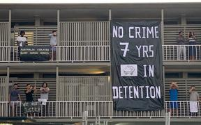 Refugees protest on balconies in the Brisbane APOD.