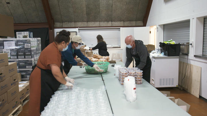 Volunteers prepare meals at Papakura Marae for those in need as unemployment rises.