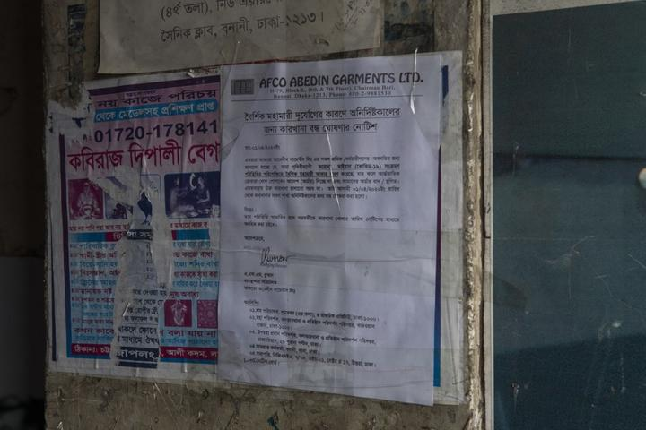 A notice on board tells about the factory shut down during the government imposed countrywide lock down amid concerns of coronavirus pandemic posing a risk of spreading Covid-19 in Dhaka.