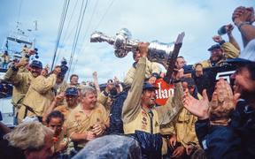 Russell Coutts lifts the Auld Mug.