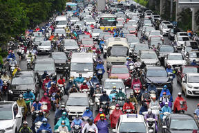 Motorists in morning rush hour traffic in Hanoi on 12 May.