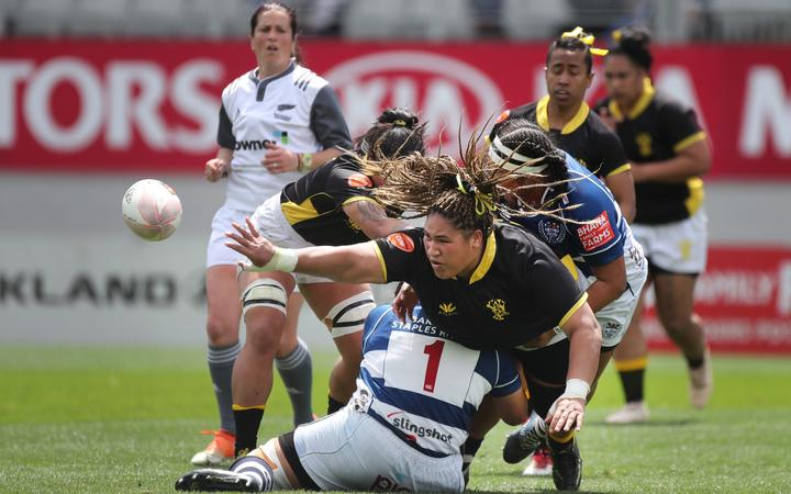 Wellington forward Janet Taumoli offloads in the tackle during the Auckland Storm vs Wellington Pride Farah Palmer Cup rugby game 2019.