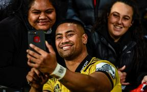 Julian Savea of the Hurricanes with fans.