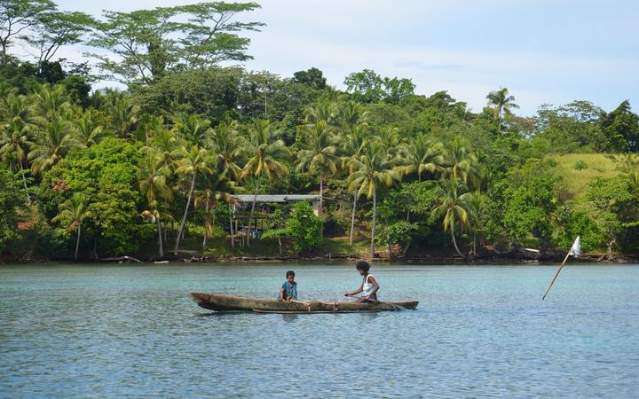 Manus Island locals in a canoe off the south coast. From here the only way to Lorengau is a two hour speed boat ride.