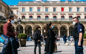 Access to the Gare de l Est train station in Paris is controlled by police officers and SNCF railway security agents on 14 May. They request certificates to move at peak hours, and maintain a distance of one metre.
