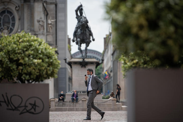 A man walks in Piazza San Carlo square in Turin, Italy. As Italy begins a staged end to Europe's longest coronavirus lockdown.