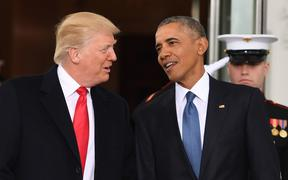 US President Barack Obama (R) welcomes President-elect Donald Trump(L)to the White House in Washington, DC January 20, 2017.