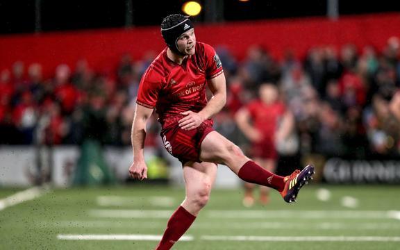 Munster's Tyler Bleyendaal kicks a conversion.