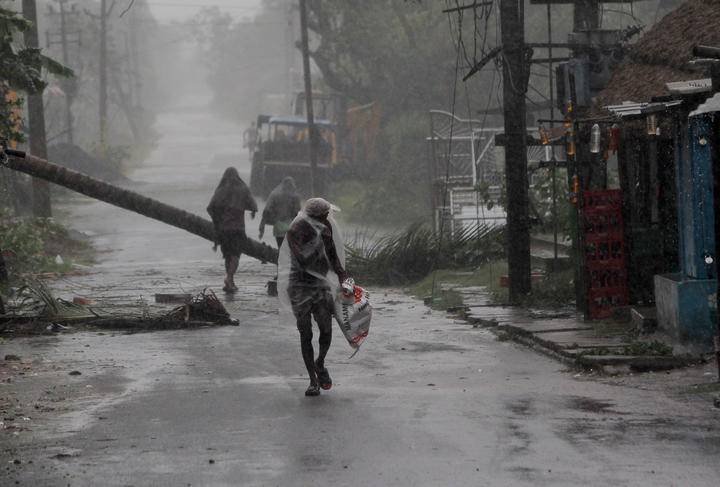 People at the Chandabali and Dhamra area of Bhadrak district, 160km from the eastern Indian state Odisha's capital city as Cyclone Amphan crosses the Bay of Bengal's eastern coast.