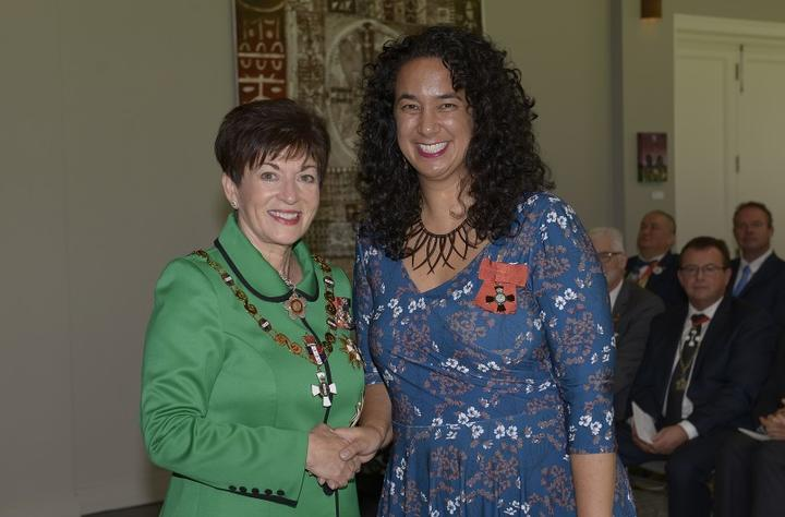 Her Excellency The Rt Hon Dame Patsy Reddy presents Ms Petrina Togi-Sa'ena her MNZM for services to Pacific music.