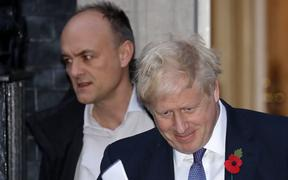Britain's Prime Minister Boris Johnson (R) and Number 10 special advisor Dominic Cummings leave from 10 Downing Street in central London on October 28, 2019.