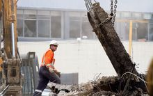 A rescue worker searches the ruins of the CTV building site four days after the 22 February 2011 earthquake.