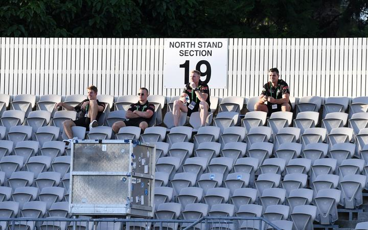 Panthers coaches watch from the empty stands.
