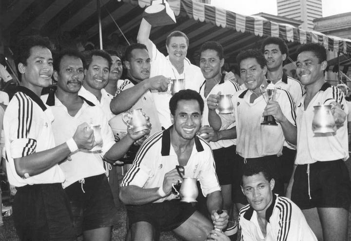 Manager Marina Schaafhausen holds winning Cup as Moata'a celebrate victory at Singapore Sevens.