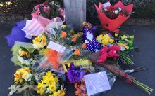 Floral tributes to the women killed and injured in the Ashburton Work and Income shootings.