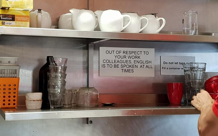The sign at Circus Circus cafe, which asks staff to speak only English.