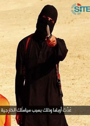An Islamic State jihadist before he apparently beheads Steven Sotloff taken from a video released by the Islamic State.