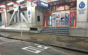 Sewage leaks onto the road outside the Police Station in central Wellington.