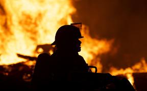 MINNEAPOLIS, MN - MAY 27: Fire fighters work to put out a fire at a factory near the Third Police Precinct on May 27, 2020 in Minneapolis, Minnesota.