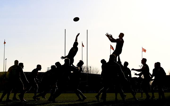 Rugby lineout in silhouette